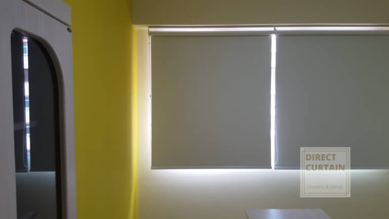 Grey roller blinds in harmony with bedroom