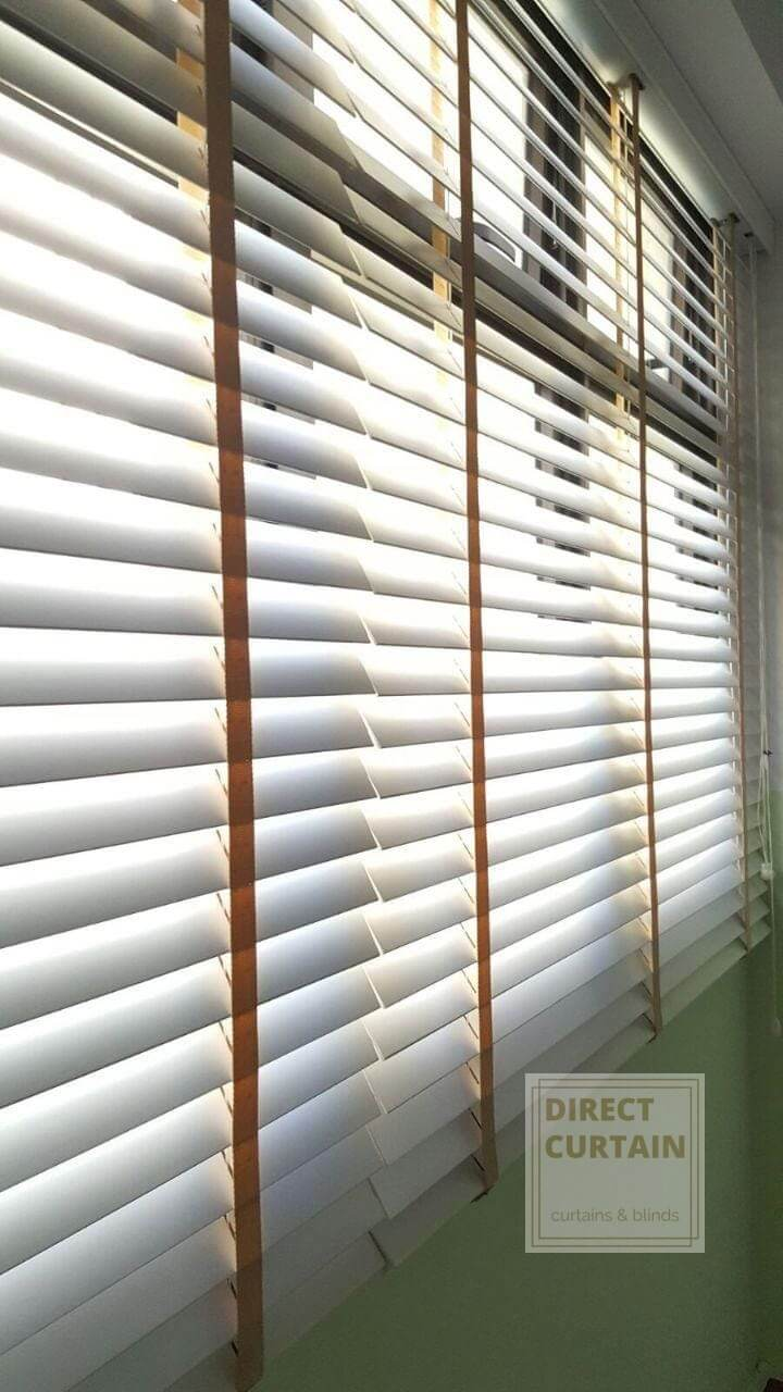 white venetian blinds with brown woven ladder tape