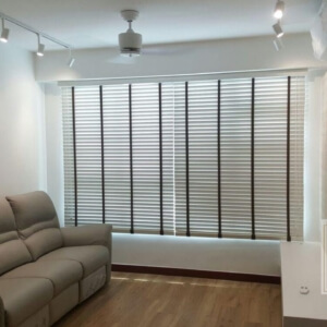 white venetian blinds with black woven ladder tape