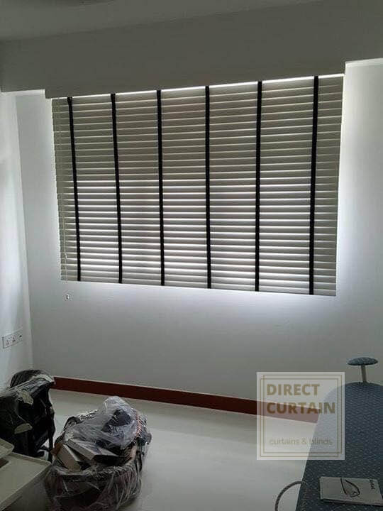 Grey venetian blinds with black woven ladder tape