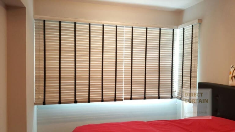 venetian blinds in L-shaped window