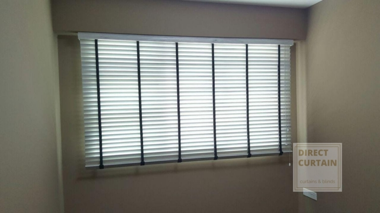 white venetian blinds in bedroom