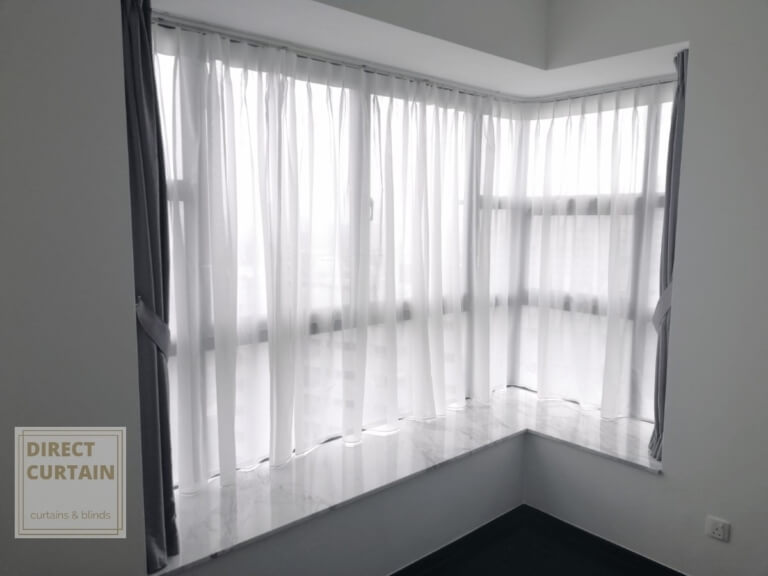 Grey dim-out night curtains and white day curtains in L-shaped windows