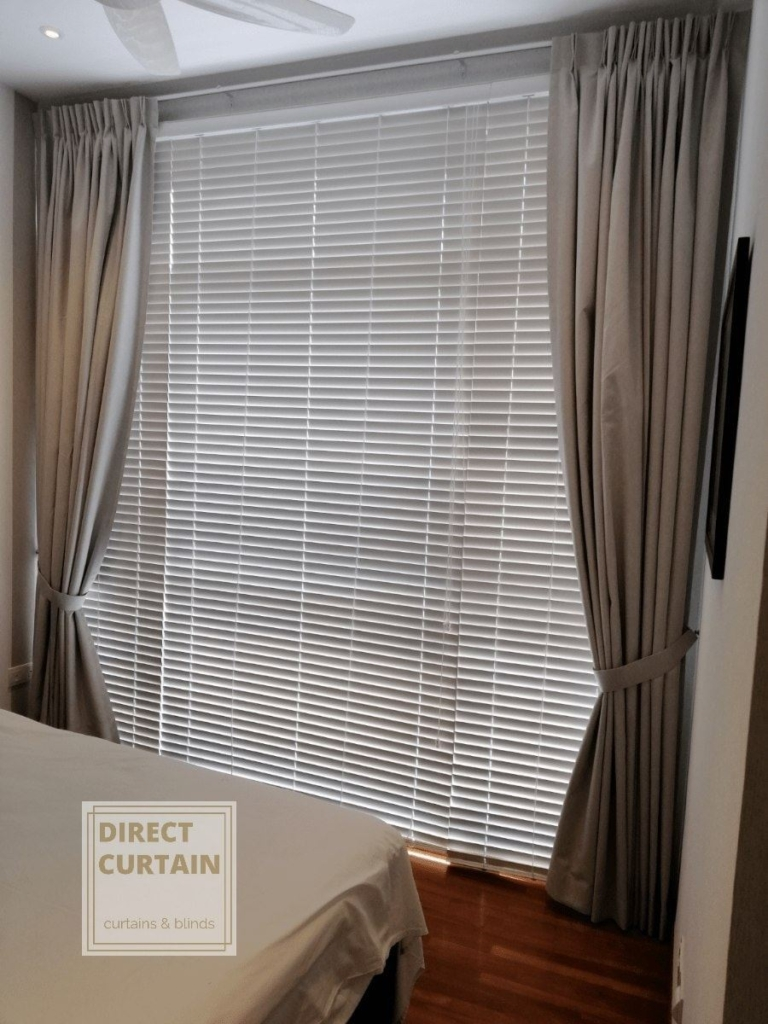 brown dim-out curtains over venetian blinds